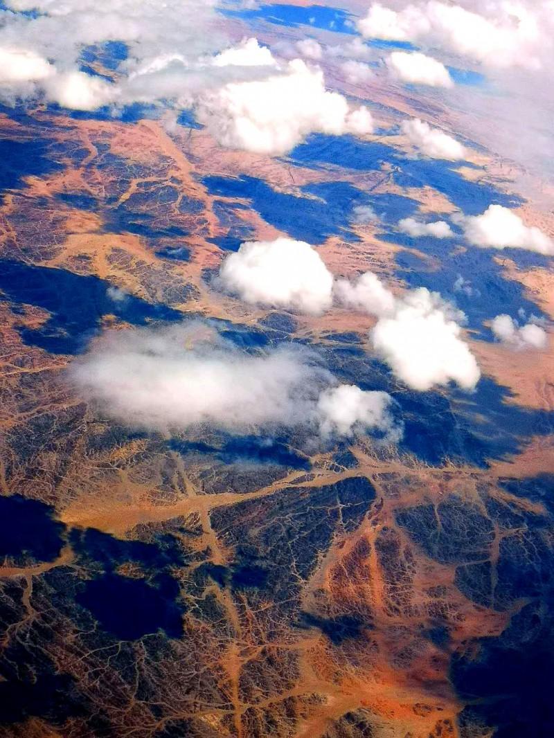 笑琰(靳新国)坐飞机时拍的照片,教你拍照小技巧